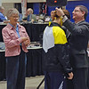 Katharine Holmes receives the 5th place medal in Junior Women's Epee from USFA Vice President Jerry Benson.