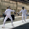 Ella Barnes competes against Helen Jolley from Northwestern University in the round of 64 of Junior Women's Epee.