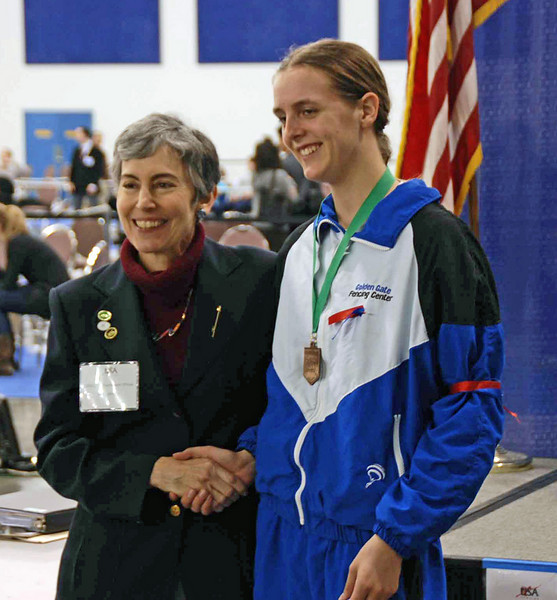 Grace Neveu receives the 8th place medal in Junior Women's Epee.