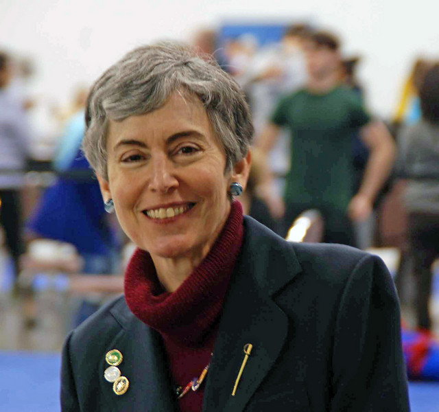 "Jane Littmann, first women's epee ""A-rated"" fencer, presented the awards for the Junior Women's Epee."