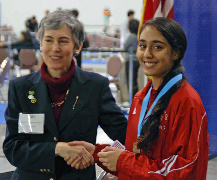 Amrit Bhinder receives the 7th place medal in Junior Women's Epee.
