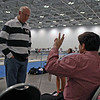 Stephen Wiggins (right) talks with Jim Townsend before the Y14 Women's Epee begins.