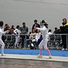 Elizabeth Wiggins (right) in the Y14 Women's Epee.  Coach Jean Finkleman watches.
