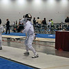 Kenneth Hill fences in the Direct Elimination Round of the Y12 Men's Epee.