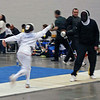 Raphael Hviding takes a warm-up lesson from Coach Jean Finkleman before the Y14 Men's Epee.