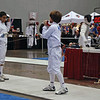 Kenneth Hill checks guards in the Y12 Men's Epee.