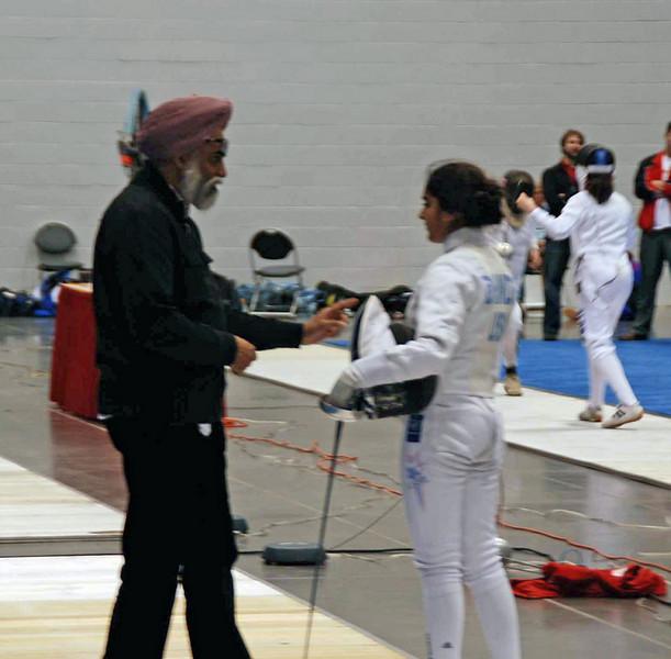 Mandeep Bhinder is Elizabeth Wiggins' opponent in the Y14 Women's Epee DE bout.