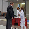 Kenneth Hill's equipment gets inspected at the start of the DE of Y12 Men's Epee.