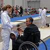 Carolyn Townsend has her equipment inspected at the start of the direct elimination Round of Y14 Women's Epee.