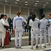 The referees gather the fencers at the start of the Y14 Women's Epee (Carolyn Townsend).