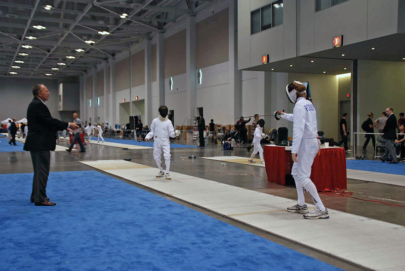 Jacob Roberts (right) fences in the DE of Y12 Men's Epee.