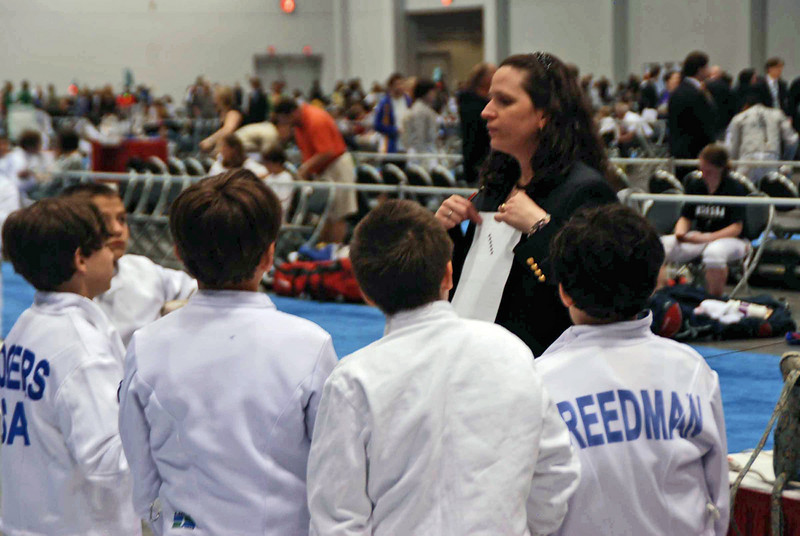 Lisa Campi, referee, instructs the Y10 Men's Epee fencers at the start of the pool.