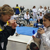 Coach Jean Finkleman talks to Elizabeth Wiggins during the 1-minute break in her Y14 Women's Epee DE bout.