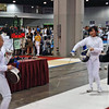 Olivia Morreale (left) starting the final period of direct elimination in Y14 Women's Epee.