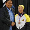 Bettie Graham receives her 5th place medal in Vet 60-69 Women's Epee.
