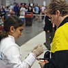 Elizabeth Wiggins getting advice from Coach Jean Finkleman during the direct elimination in Y14 Women's Epee.