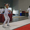 Olivia Morreale (left) in the direct elimination of Division III Women's Epee.