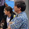Stephen Wiggins and Elizabeth Wiggins watch Daniel in the Y14 Men's Epee.