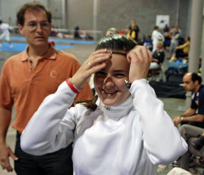 Nina Moiseiwitsch getting ready for the U16 Women's Epee.  (Julian Moiseiwitsch in background.)