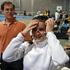 Nina Moiseiwitsch getting ready for the U16 Women's Epee.  (Julian Moiseiwitsch in background.)