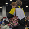 Jacob Roberts speaks with Coach Jean Finkleman during the break in the direct elimination round of the Y12 Men's Epee.