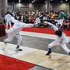 Seth Flanagan (left) in the Y14 Men's Epee.