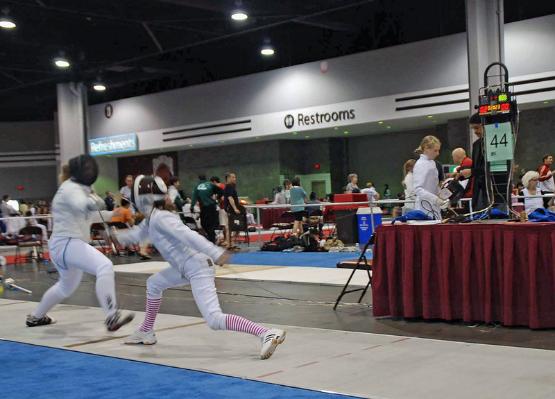 Elizabeth Wiggins (right) in the direct elimination of the Y12 Women's Epee.