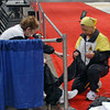 Bettie Graham helps Mary Annavedder with her warm-up suit prior to the Veteran-70+ Women's Epee award ceremony.