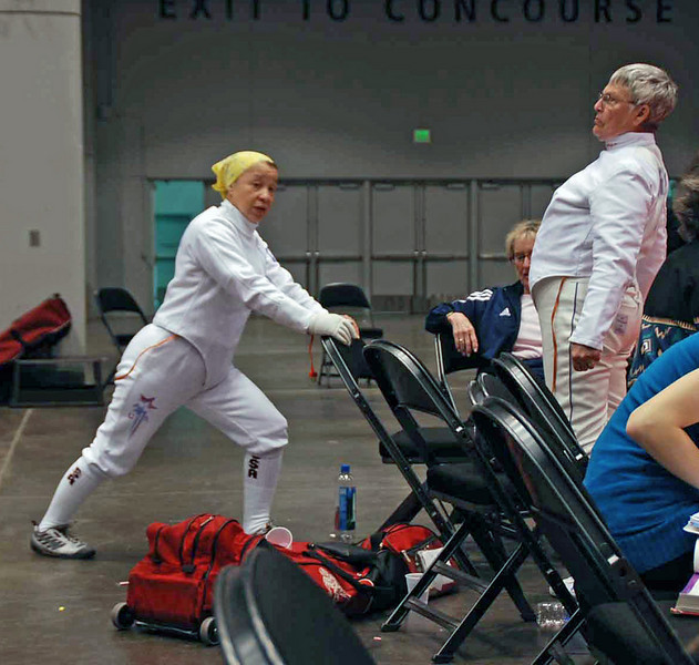 Bettie Graham (left) and Terry Abrahams stretch before the Veteran-70+ Women's Epee event.