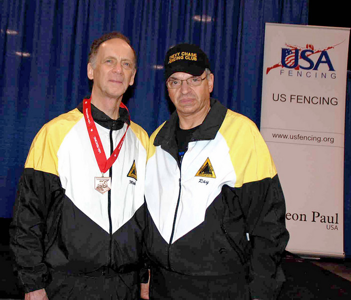 Mark Henry (left) with his coach, Fencing Master Raymond Finkleman.