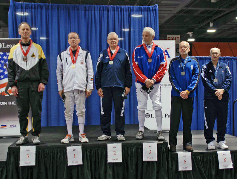 The finalists in Veteran-70+ Men's Epee, from left: Mark Henry (3rd), James Adams (1st), Alexander Kocsy (2nd), Kazimieras Campe (3rd), Donald Penner (6th), and Edward Sady (8th).  Not present: Marcel Miernik (5th) and William Hall (7th).