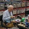 Dan Dechaine working the Sword Masters repair booth.