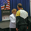 Mark Henry receives his bronze medal from Diane Kallus, member of the Veteran Fencers Committee who has competed in 10 World Championships.