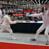 Mark Henry (right) scores a touch in the Veteran-70+ Men's Epee.