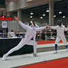 Carolyn Townsend (left) scores a touch in the Division II Women's Epee.
