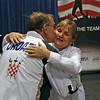 James Adams, gold medalist in the Veteran-70+ Men's Epee, thanks Diane Kallus at the award presentation.