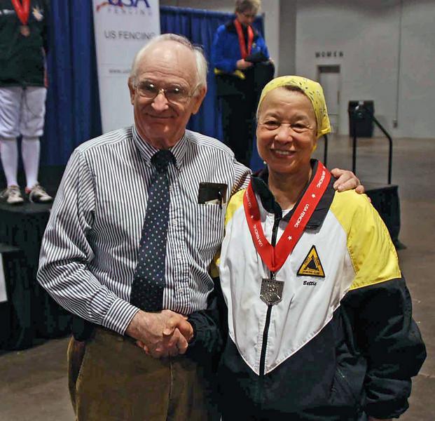 Bettie Graham receives her silver medal from Dan Dechaine.