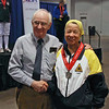 Bettie Graham receives her silver medal from Dan Dechaine.