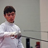 Sam Hayden tests guards with his opponent in the Junior Men's Epee.