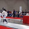 Ella Barnes (left) scores on her opponent in the Junior Women's Epee.