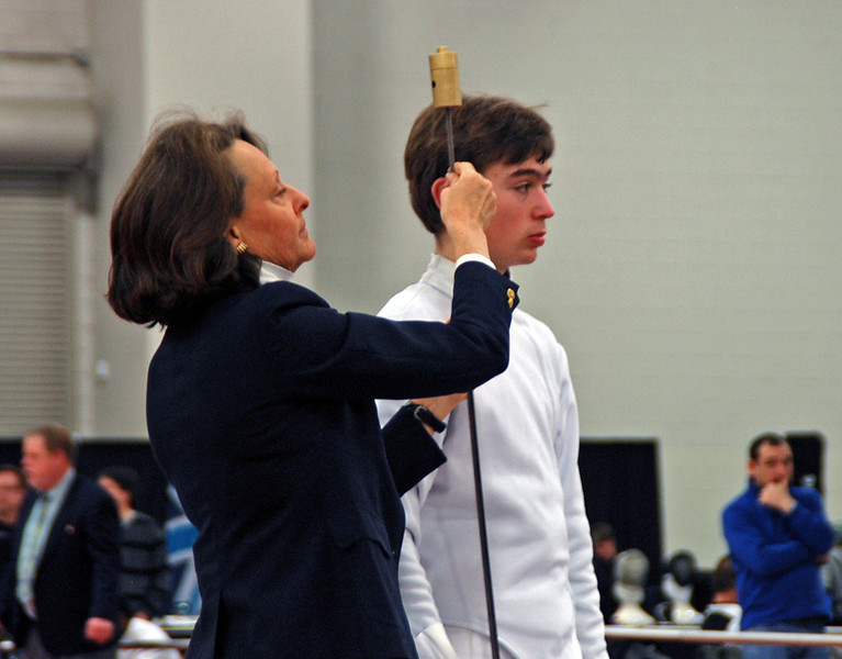 Sam Hayden has his weapon tested by referee Judith Offerle in the Junior Men's Epee at the 2012 Junior Olympic Championships.