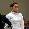 The referee inspects Ella Barnes' epee in the Junior Women's Epee.
