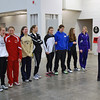 The finalists in Junior Women's Epee gather before the presentation of awards.  Carol Buerdsell (always in pink) is in charge of the award presentations.