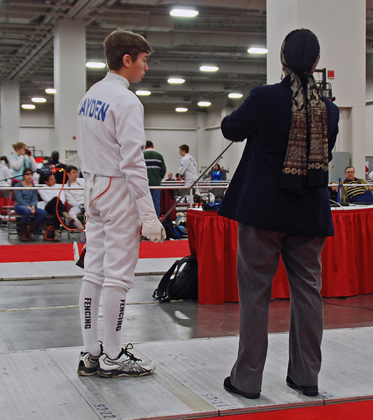 Sam Hayden has his weapon checked in the Cadet Men's Epee.