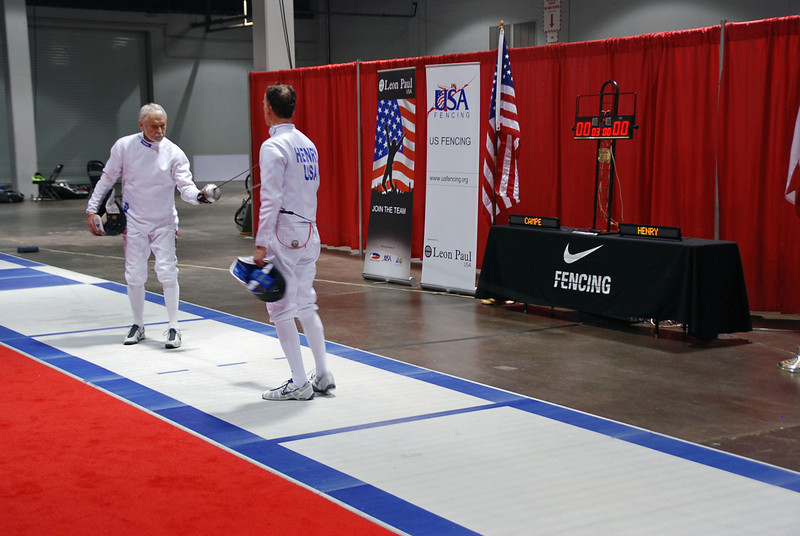 Mark Henry (right) prepares to fence in the gold medal bout against Kaz Campe.