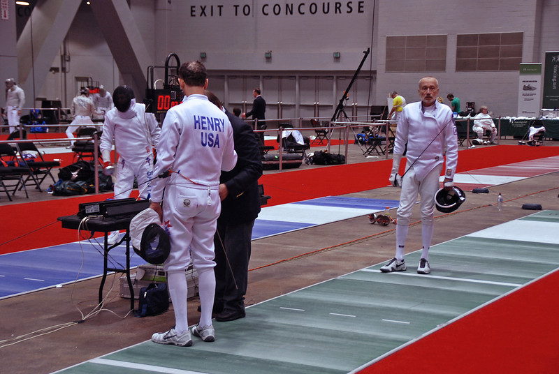 Mark Henry fences against Donald Penner in the DE round of Veteran-70+ Men's Epee.