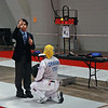 The referee checks Bettie Graham's foil at the start of the Veteran-70+ Women's Foil.