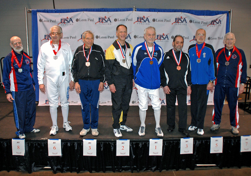 The finalists in Veteran-70+ Men's Epee (from left): Richard Dunlop (8th), Carl Herkstroeter (6th), Marcel Miernik (3rd), Mark Henry (2nd), Kazimieras Campe (1st), Stephan Khinoy (3rd), Donald Penner (5th), Robert Baldwin (7th).