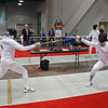 Raphael Hviding (left) in the Division III Men's Epee.