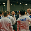 Division III Men's Epee fencers gather to receive instructions from referee Donald Alperstein at the start of the direct elimination round.